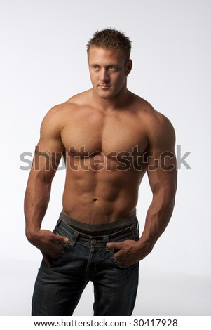 Muscle guy with jeans on white background - stock photo