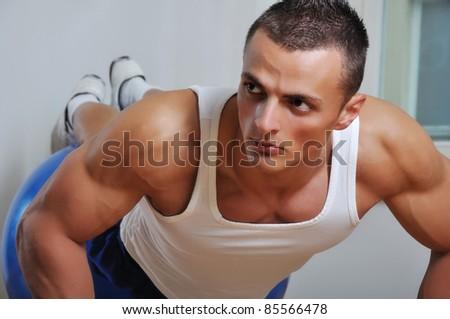 Muscle man doing push ups - stock photo