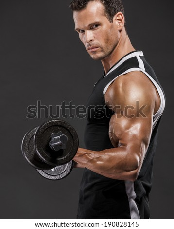 Muscle man lifting weights, isolated over a white background - stock photo