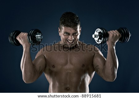 Muscle man, lots of muscles, working out, loving life. Very well built, very attractive. - stock photo