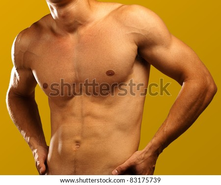 muscle man on a golden background - stock photo