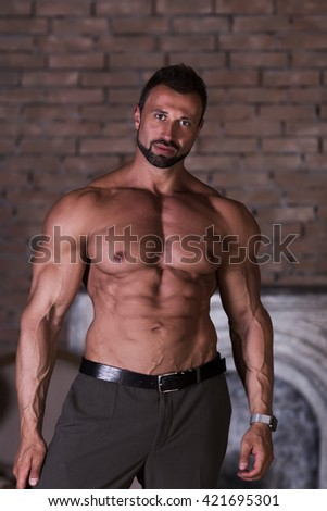 Muscle man poses shows press