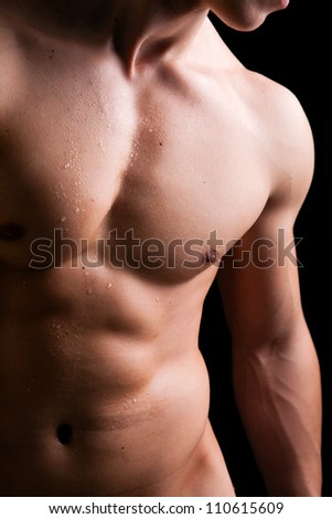 Muscle man torso with drops a water - stock photo