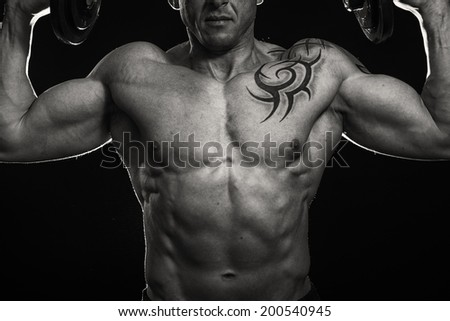 Muscle man with tattoos.Black and white - stock photo