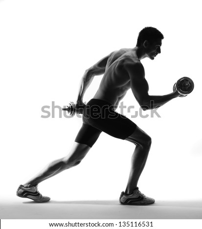 muscle model guy making push ups exercise over gray background. - stock photo