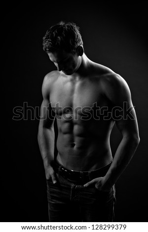 Muscle sexy naked young man with perfect body posing in jeans - stock photo