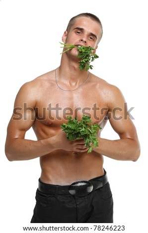 Muscle sexy wet naked young man eating the parsley