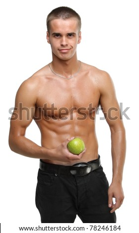 Muscle sexy wet naked young man hold the green apple in hands