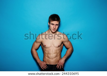 Muscle sexy young man - stock photo