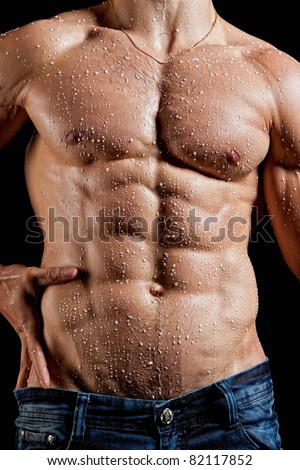 Muscle sexy young man torso perfused milk - stock photo
