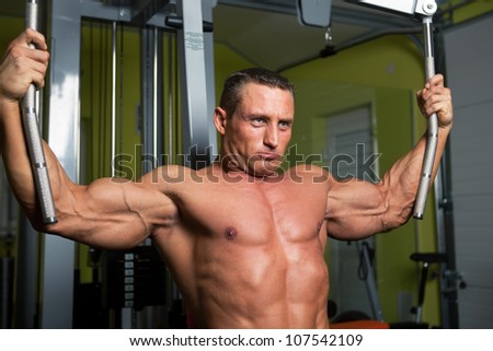 Muscle shaped man exercise on sport gym fitness club - stock photo