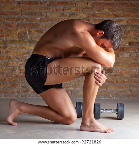 muscle shaped man on knee thinking with thinker posture