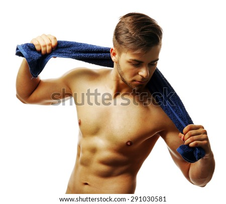Muscle young man holding towel isolated on white - stock photo