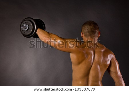 Muscled male bodybuilder weight, dumbbell, raise, swing - stock photo