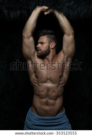 Muscled male model in studio - stock photo