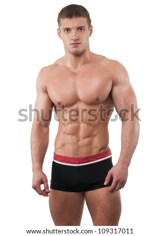 Muscled male model on isolated white - stock photo