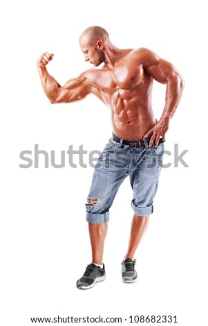 Muscled male model posing in studio at white background - stock photo