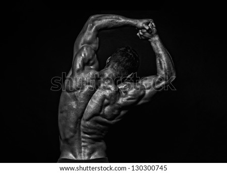Muscled male model showing his back - stock photo