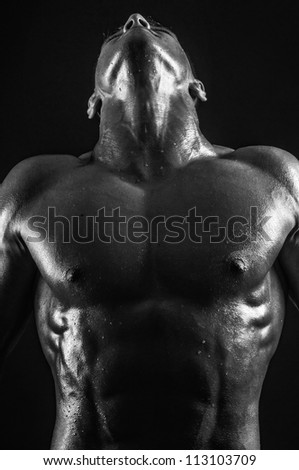 Muscled male model showing his neck - stock photo