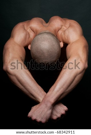 Muscled male model showing his shoulders and back - stock photo