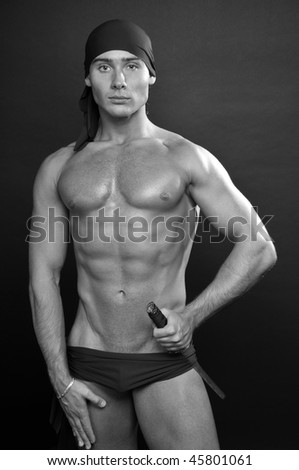 Muscled male model with japaneses sword - stock photo