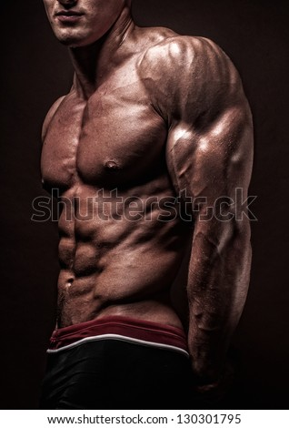 Muscled male model with strong arms - stock photo