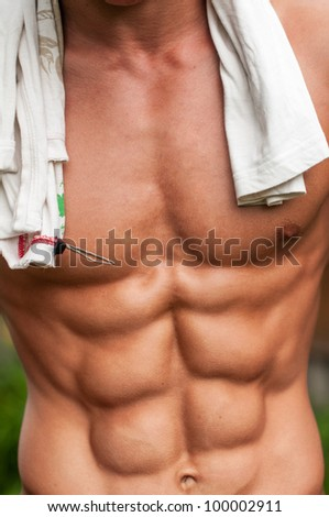 Muscled male torso with low body fat - stock photo