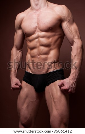 Muscled male torso with strong abs - stock photo