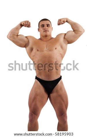 Muscled model posing.Isolated on white background - stock photo