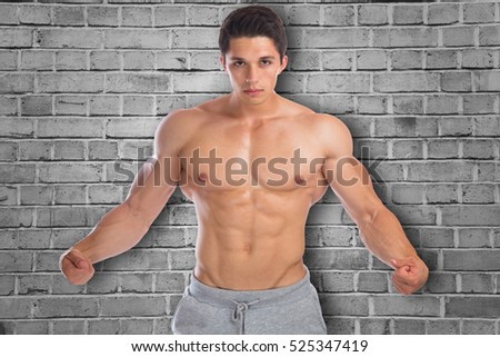 Muscles flexing posing bodybuilder bodybuilding strong muscular young man