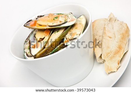 Muscles in white wine and garlic sauce - stock photo