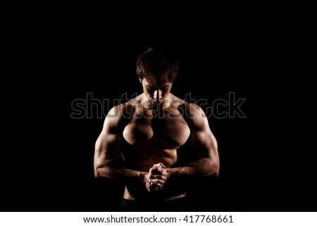 Muscular and fit young bodybuilder fitness male model posing over black background. Perfect fitness WET body with DROPS. Ideal for commercial. ABS - stock photo
