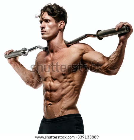 Muscular and fit young bodybuilder posing demonstrates the core muscles. Isolated on white background. - stock photo
