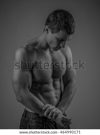 Muscular and fit young man posing shirtless
