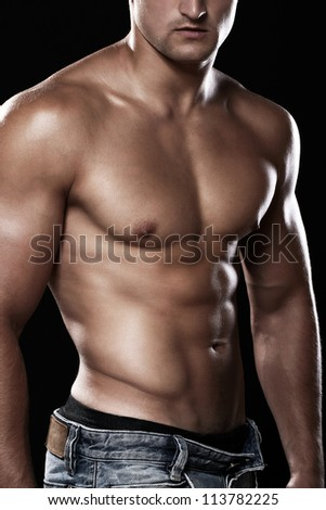 Muscular and sexy torso of young man - stock photo