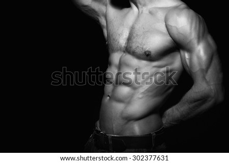 Muscular and sexy torso of young man with perfect abs. Black and white - stock photo