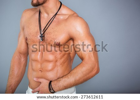 Muscular and sexy torso of young man with perfect body - stock photo