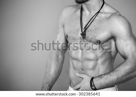 Muscular and sexy torso of young man with perfect muscular body in panties. Black and white - stock photo