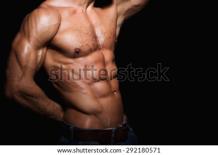 Muscular and sexy torso of young sport man. Attractive bodybuilder body with perfect abs, chest, bicep, triceps