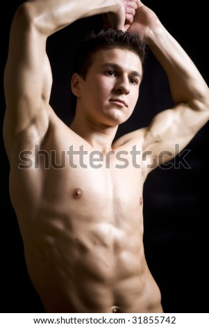 Muscular and tanned male - stock photo