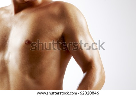 Muscular arm and chest - stock photo