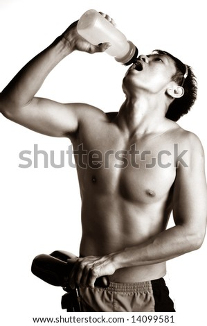 muscular asian man hydrating himself - stock photo