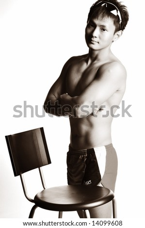 muscular asian man in monochrome - stock photo