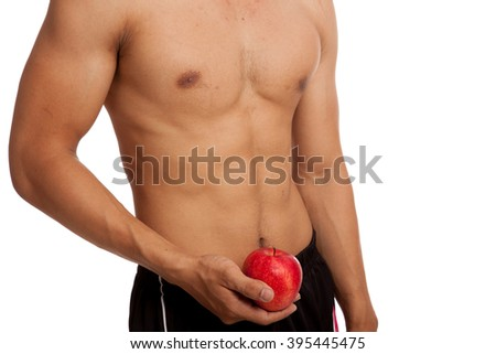 Muscular Asian man show six pack abs with red apple  isolated on white background - stock photo