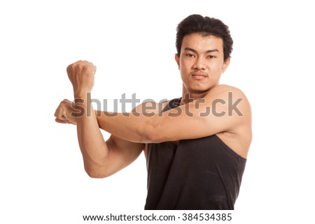 Muscular Asian man stretching his arm  isolated on white background - stock photo