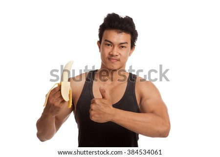 Muscular Asian man thumbs up with peeled banana  isolated on white background