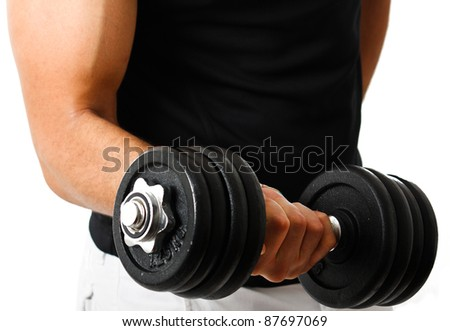 Muscular athlete lifting a weight in the gym - stock photo
