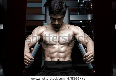 Muscular athletic bodybuilder fitness model
