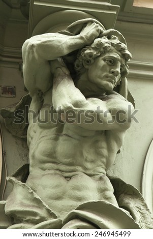 Muscular atlas supporting a Baroque building in Prague, Czech Republic. - stock photo