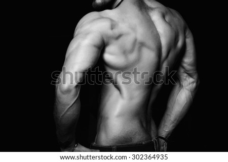 Muscular back and sexy torso of young man. Perfect back muscles and triceps. Black and white - stock photo